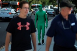 Colin Best who poses as an alien is spotted on his walk toward the White House in Washington, D.C. on July 24, 2013.